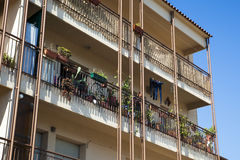 Apartments in Mediterranean summer, with balconies, plants and w Royalty Free Stock Photography