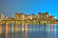 Apartments by the river at night Stock Photography