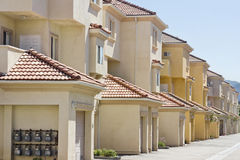 Apartments in a Row. Apartments line up in a row in a suburban community royalty free stock photos
