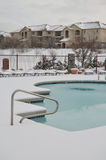 Apartments and swimming pool in the snow Stock Images