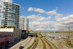 Apartments, train-tracks and cars at vancouver's waterfront Royalty Free Stock Photo