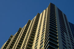 Apartments Up. Looking up at a patterned apartment building against a deep blue sky Stock Photography