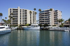 The Apartments and Yacht. There were two building apartments and two yachts at the New Port Beach docked at Pier Stock Photos