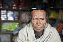 Apatani Tribe. Ziro, Arunachal Pradesh/India - December 13, 2013: Man from the Apatani tribe. The Apatani are a tribal group of people living in the Ziro valley royalty free stock photo