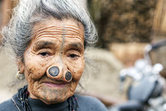 Apatani Tribe. Ziro, Arunachal Pradesh/India - December 13, 2013: Woman from the Apatani tribe, with nose plugs, The Apatani are a tribal group of people living stock photography