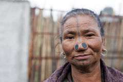 Apatani Tribe. Ziro, Arunachal Pradesh/India - December 13, 2013: Woman from the Apatani tribe, with nose plugs, The Apatani are a tribal group of people living stock photo
