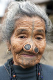 Apatani Tribe. Ziro, Arunachal Pradesh/India - December 13, 2013: Woman from the Apatani tribe, with nose plugs, The Apatani are a tribal group of people living royalty free stock photos