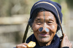 Apatani Tribe. Ziro, Arunachal Pradesh/India - December 14, 2013: Woman from the Apatani tribe, with nose plugs, The Apatani are a tribal group of people living royalty free stock image