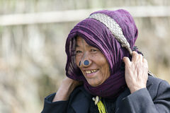 Apatani Tribe. Ziro, Arunachal Pradesh/India - December 14, 2013: Woman from the Apatani tribe, with nose plugs, The Apatani are a tribal group of people living stock photo