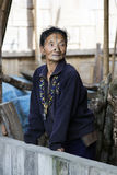 Apatani Tribe. Ziro, Arunachal Pradesh/India - December 14, 2013: Woman from the Apatani tribe, with nose plugs, The Apatani are a tribal group of people living stock image