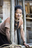 Apatani Tribe. Ziro, Arunachal Pradesh/India - December 14, 2013: Woman from the Apatani tribe, with nose plugs, The Apatani are a tribal group of people living stock photos