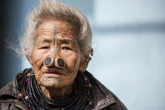Apatani Tribe. Ziro, Arunachal Pradesh/India - December 14, 2013: Woman from the Apatani tribe, with nose plugs, The Apatani are a tribal group of people living royalty free stock photos