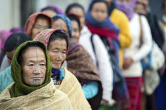 Apatani Tribe. Ziro, Arunachal Pradesh/India - December 14, 2013: Women from the Apatani tribe, with nose plugs, The Apatani are a tribal group of people living royalty free stock photo