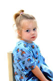 Apathetic. Little girl sits apathetic in blue print hospital gown.  She stares off into space as if dreaming of running and playing Stock Photos