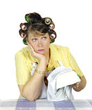 Apathetic Housewife. Bored and apathetic housewife sick of wiping the dishes Stock Images