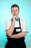 Apathetic Store Clerk. This image shows a sales clerk with closed body language Stock Images