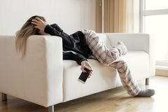 Apathic lazy woman lying in sofa stock photo
