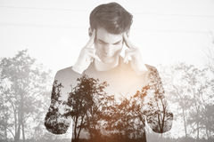Apathy concept. Pensive young guy on dull landscape background. Apathy concept Royalty Free Stock Photos