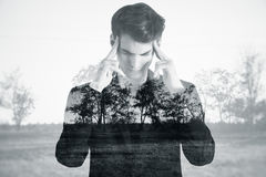 Apathy concept. Pensive young male on dull landscape background. Apathy concept Stock Images
