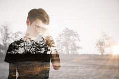 Apathy concept. Pensive young man on dull landscape background. Apathy concept Royalty Free Stock Photos