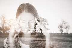 Apathy concept. Pensive young woman on dull landscape background. Apathy concept Stock Images