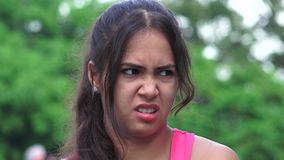 Apathy fear disgust female teen. A pretty young Colombian teen girl stock footage