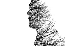 Human profile made of bare tree branches. Human profile silhouette made of bare tree branches as depression and feeling concept Royalty Free Stock Photos