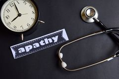 Apathy on the paper with Healthcare Concept Inspiration. alarm clock, Black stethoscope. royalty free stock images