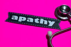 Apathy on the paper with medicare Concept. Inspiration. Stethoscope on pink bakcground stock photos