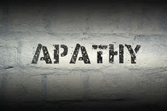 Apathy word gr. Apathy stencil print on the grunge white brick wall Stock Photography