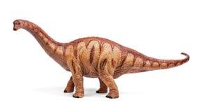 Apatosaurusdinosaurieleksak som isoleras på vit bakgrund med den snabba banan Royaltyfria Bilder