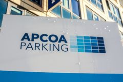 APCOA Parking brand logo on the building. MUNICH, GERMANY - DECEMBER 26, 2018: APCOA Parking brand logo on the building in Business Park of Munich, Germany stock photography