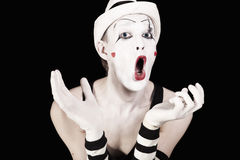 Ape mime in striped gloves and white hat Royalty Free Stock Images