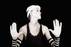 Ape mime in striped gloves and white hat Stock Photography