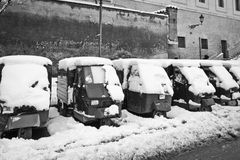 Ape Piaggio parked in the snow. The Piaggio Ape is a three-wheeled light commercial vehicle Royalty Free Stock Photo