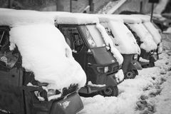 Ape Piaggio parked in the snow. The Piaggio Ape is a three-wheeled light commercial vehicle Stock Image