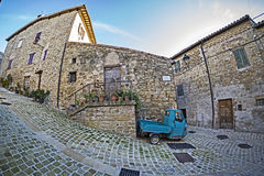 Ape Piaggio in picturesque corner Royalty Free Stock Images