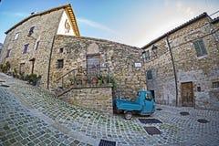 Ape Piaggio in picturesque corner. Of Crispiero, le Marche, Italy Royalty Free Stock Images