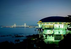 APEC House. Nurimaru or APEC House, the venue for the 2005 APEC summit which has now become a major tourist attraction. In the background Busan Harbor and Royalty Free Stock Photos