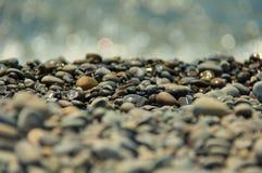 Apedreja seixos na praia Imagem de Stock Royalty Free
