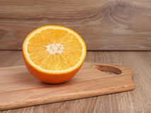 Apelsin. A half of orange on a board culinary Stock Image