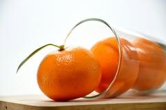 Apelsin i exponeringsglas Royaltyfria Foton