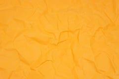 Apelsin knövlat papper Fotografering för Bildbyråer