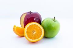Apelsin och äpplen Arkivfoto