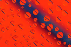 Apelsin- och blåttsmå droppar Arkivbild