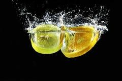 Apelsin- och citronfärgstänk Arkivbilder