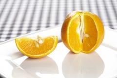 Apelsin och en fjärdedel Royaltyfri Bild