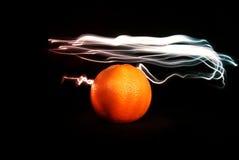 Apelsin och ljus 1 arkivbilder