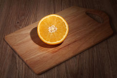 Apelsin. Orange on a board culinary Stock Images