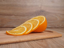Apelsin. Orange on a board culinary Stock Photos